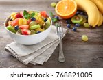 bowl with delicious fruit salad ... | Shutterstock . vector #768821005