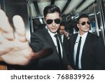 bodyguards stopping paparazzi... | Shutterstock . vector #768839926