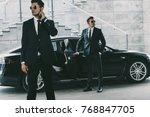 bodyguards in sunglasses... | Shutterstock . vector #768847705