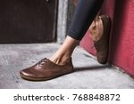 lady wearing brown leather shoes | Shutterstock . vector #768848872