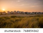 the beach huts at mudeford in...