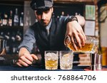 barman pouring whiskey cocktail ... | Shutterstock . vector #768864706