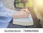 woman pray with bible in the... | Shutterstock . vector #768864886