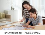 portrait of young asian couple... | Shutterstock . vector #768864982