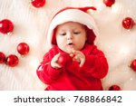 cute baby with christmas balls... | Shutterstock . vector #768866842