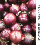 beautiful red onions | Shutterstock . vector #768877768