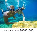 underwater photo of a young... | Shutterstock . vector #768881905