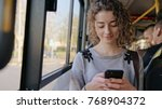 a young lady using a smartphone ... | Shutterstock . vector #768904372