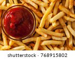 delicious french fries and... | Shutterstock . vector #768915802