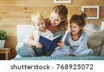 happy family mother reading to  ... | Shutterstock . vector #768925072