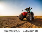 farmer fertilizing arable land... | Shutterstock . vector #768933418