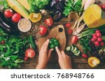 woman hands cutting vegetables... | Shutterstock . vector #768948766