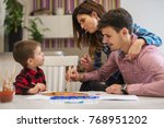 happy family drawing together. | Shutterstock . vector #768951202