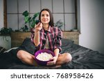 woman watching funny movie... | Shutterstock . vector #768958426
