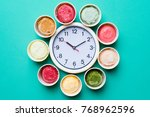 ice cream with a clock on green ... | Shutterstock . vector #768962596