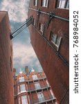 facades of brick houses in... | Shutterstock . vector #768984052