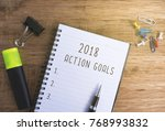 new year resolutions on notepad ...   Shutterstock . vector #768993832