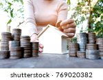 coins placed on the wooden... | Shutterstock . vector #769020382