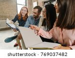interns laughing at their notes | Shutterstock . vector #769037482