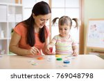 kid plays logical game at the... | Shutterstock . vector #769048798