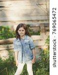 portrait of a little girl... | Shutterstock . vector #769065472