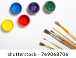 paints in jars and a brush on a ... | Shutterstock . vector #769068706