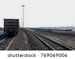 piles of coal next to a train... | Shutterstock . vector #769069006