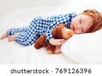 adorable redhead toddler baby... | Shutterstock . vector #769126396