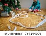 christmas morning   young boy... | Shutterstock . vector #769144006