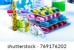 Small photo of Drug prescription for treatment medication. Pharmaceutical medicament, cure in container for health. Pharmacy theme, capsule pills with medicine antibiotic in packages.