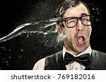 surprised elegant nerd with... | Shutterstock . vector #769182016