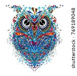 Stock vector kaleidoscopic owl in red blue tones 769189048