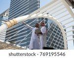 two arab businessmen convene to ... | Shutterstock . vector #769195546