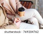 closeup of coffee cups in hands ... | Shutterstock . vector #769204762