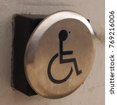 Small photo of Square format of a closeup view on a disability door accessibility button.