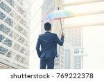 businessman  mbrella stand ... | Shutterstock . vector #769222378