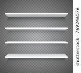 empty white shop shelf on... | Shutterstock .eps vector #769246576