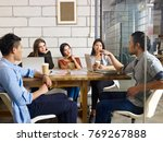 team of young asian and... | Shutterstock . vector #769267888