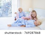 kids playing in parents bed in... | Shutterstock . vector #769287868