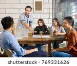 team of young asian and... | Shutterstock . vector #769331626