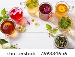 herbal tea in cups on a white... | Shutterstock . vector #769334656