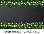 fir branch with neon lights on... | Shutterstock . vector #769337212