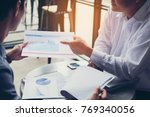 business people are negotiating ... | Shutterstock . vector #769340056