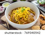 egg noodle in chicken curry | Shutterstock . vector #769340542