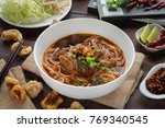 rice noodles with spicy pork... | Shutterstock . vector #769340545