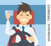 happy man showing his driver... | Shutterstock .eps vector #769348315