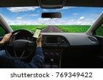 man hand using gps navigation... | Shutterstock . vector #769349422