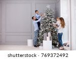 family decorating a christmas... | Shutterstock . vector #769372492
