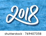 happy new year 2018. paper 3d... | Shutterstock . vector #769407358