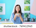 young woman holding bowl of... | Shutterstock . vector #769412965